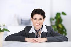 Beautiful receptionist with a welcoming smile Stock Photos