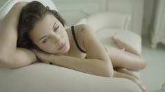 Beautiful brunette model relaxing in her boudoir - stock footage