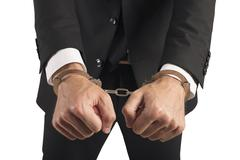 Handcuffed businessman in jail Stock Photos