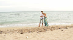 Couple Collecting Shells - stock footage
