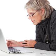 Stock Photo of senior woman working on a laptop
