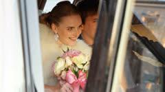 Happy Newlyweds In Wedding Car - stock footage