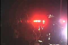 Stock Video Footage of Silhouettes of People Talking in Front of a Fire Truck