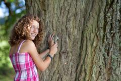 young scientist looking at tree - stock photo