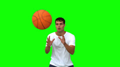 Man catching and throwing a basketball on green screen Stock Footage