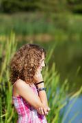 teenage girl near a lake - stock photo