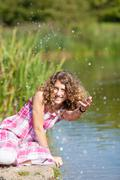 happy teenage girl playing with water - stock photo