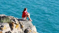 Young beautiful woman near the sea Stock Footage