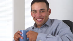 Latino business man laughing and smiling at camera - stock footage