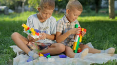 Two boys outside on the lawn gather designer Stock Footage