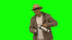Man pouring coffee from a vacuum flask on green screen Stock Footage