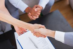 Stock Photo of Salesman shaking hand with client