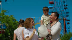 Happy Family In Amusement Park Stock Footage