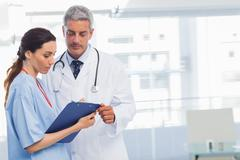 Stock Photo of Nurse and doctor looking a file