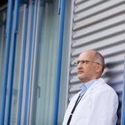 doctor leaning on wall - stock photo