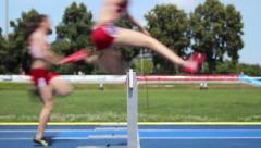 Loop hurdle female runners Stock Footage