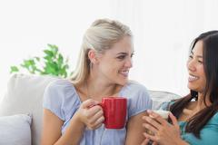 Stock Photo of Blonde woman chatting with her friend