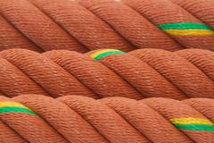closeup of manila nylon ropes use for background - stock photo