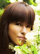 Girl ang flowers - stock photo