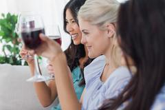 Happy friends having red wine together Stock Photos