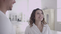 Young happy mixed race couple viewing a beautiful home to buy or rent - stock footage