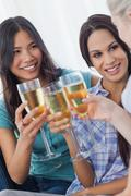Cheerful friends enjoying white wine together - stock photo