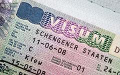 Page of passport with Schengen visa - stock photo