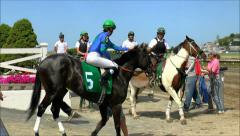 Horse racing handlers head to track gates Stock Footage