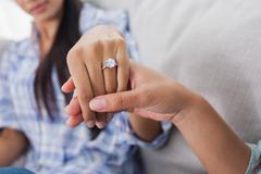 Engagement ring on womans hand Stock Photos