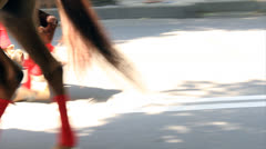 Horses legs on sunlit street Stock Footage