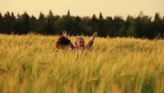 Happy mother and daughter have fun on a wheat field. Stock Footage
