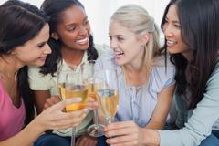 Stock Photo of Friends toasting with white wine