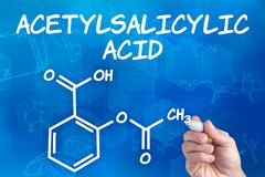 hand with pen drawing the chemical formula of acetylsalicylic acid - stock photo