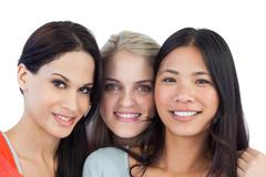Diverse young women smiling at camera - stock photo