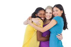Diverse young women embracing each other - stock photo