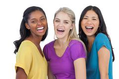 Diverse laughing women looking at camera - stock photo