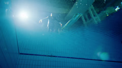 Drowning underwater businessman, falls into the water and remains motionless - stock footage