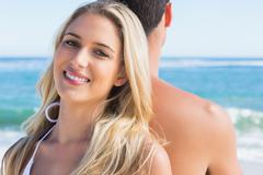 Stock Photo of Blonde smiling and leaning against her boyfriend