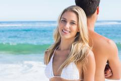 Stock Photo of Pretty blonde smiling and leaning against her boyfriend