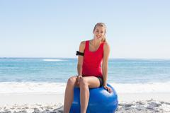 Stock Photo of Fit young blonde sitting on exercise ball