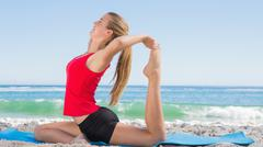 Stock Photo of Athletic blonde stretching leg in yoga pose