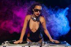 Beautiful DJ girl - stock photo