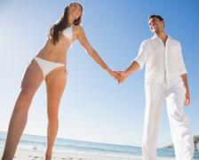 Stock Photo of Pretty blonde holding hands with boyfriend