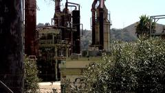 Old Abandoned Oil Refinery Ventura industrial machinery industry metal pipe Stock Footage