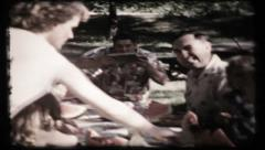 270 - the family enjoy watermelon in the park - vintage film home movie Stock Footage