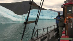 Greenland photographers on a boat in an ice fjord Stock Footage