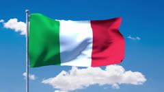Italian flag waving over a blue cloudy sky - stock footage