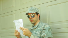 Soldier read reading letter look Stock Footage