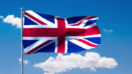 Stock Video Footage of UK flag waving over a blue cloudy sky