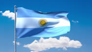 Stock Video Footage of Argentinian flag waving over a blue cloudy sky